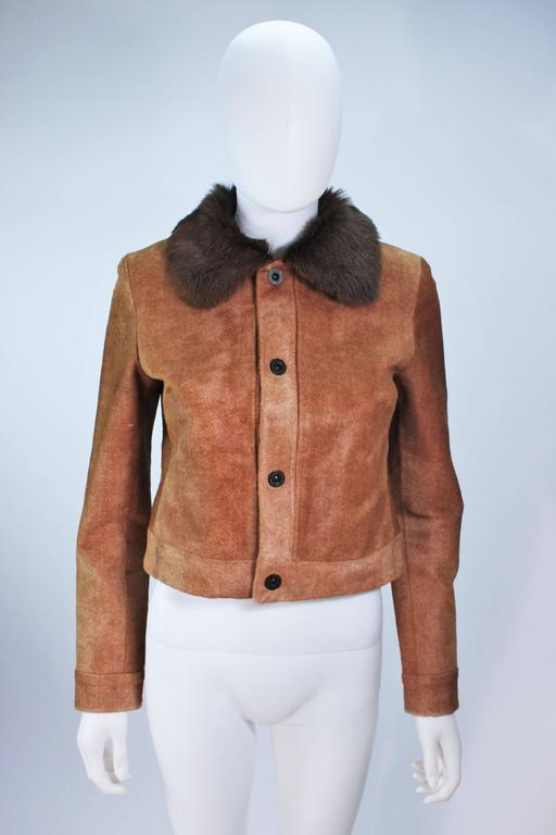 This Ralph Lauren  jacket is composed of a sheared chevron patterned cowhide with fur collar trim. There are center front snap closures. In excellent condition, some natural variations in fur, hardly used. 