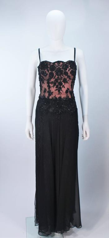 This Fe Zandi gown is composed of a black chiffon and beaded lace with a nude underlay. Features a front sheer chiffon drape, with lace,  and center back zipper closure. In excellent vintage condition.    **Please cross-reference measurements for