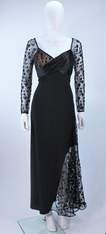 This Travilla  gown is composed of black silk and features beaded lace accenting with a nude underlay. There is a center back zipper closure. In excellent vintage condition.    **Please cross-reference measurements for personal accuracy.