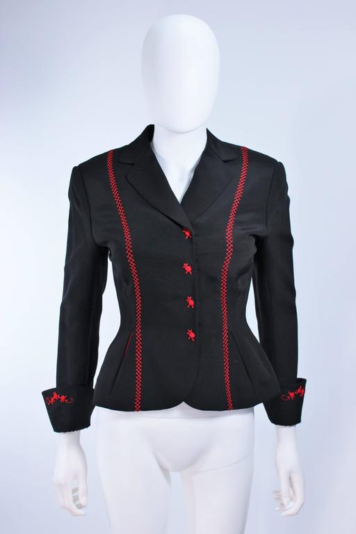 This jacket is composed of a black fabric with red top-stitch. Features center front snap closures with red rose embroidered design. In excellent vintage condition.  **Please cross-reference measurements for personal accuracy. Size in description