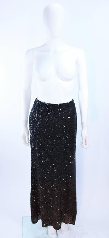 This Bill Blass design is composed of a black to brown sequin ombre. There is a side zipper closure. In excellent vintage condition.