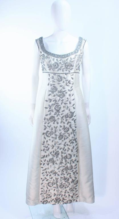 This Lillie Rubin design is composed of an off white raw silk with rhinestone embellishment in a floral patter. There is a center back zipper closure. In excellent vintage condition.  **Please cross-reference measurements for personal accuracy.