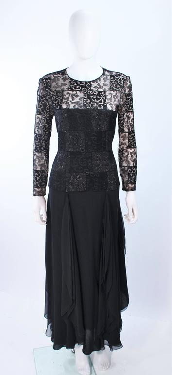 This Carolina Herrera gown is composed of a black metallic lace bodice with draped chiffon skirt. There is a zipper closure. In excellent vintage condition.