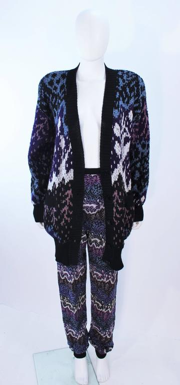 This Missoni design is composed of navy, blue, and purple patterned knit. The cardigan features center front button closures and pockets. The pants have a jogger style. In excellent vintage condition.  **Please cross-reference measurements for