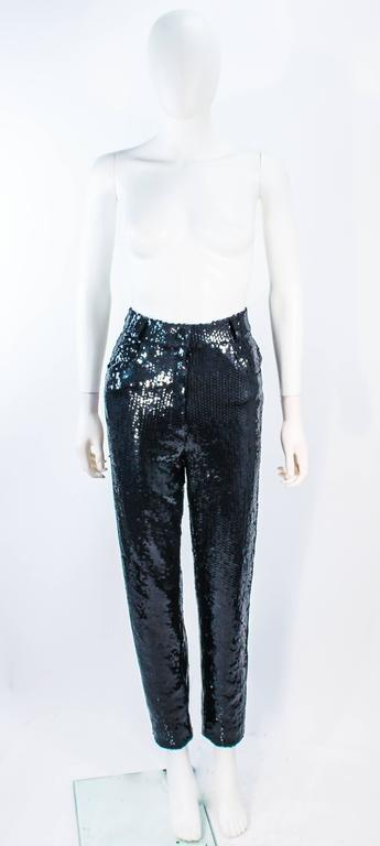 These Suite 101 pants are composed of black sequins on a stretch material. Features a high waist style. In excellent vintage condition.   **Please cross-reference measurements for personal accuracy. Size in description box is an estimation.