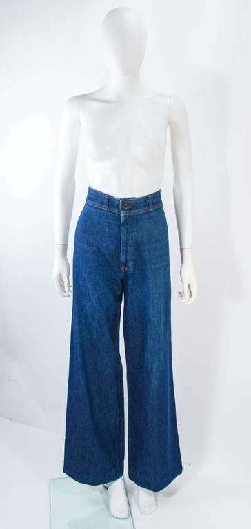 These Levi's are composed of a stone washed denim. Features a wide leg high waist style with a center front zipper. In excellent vintage condition.  **Please cross-reference measurements for personal accuracy. Size in description box is an