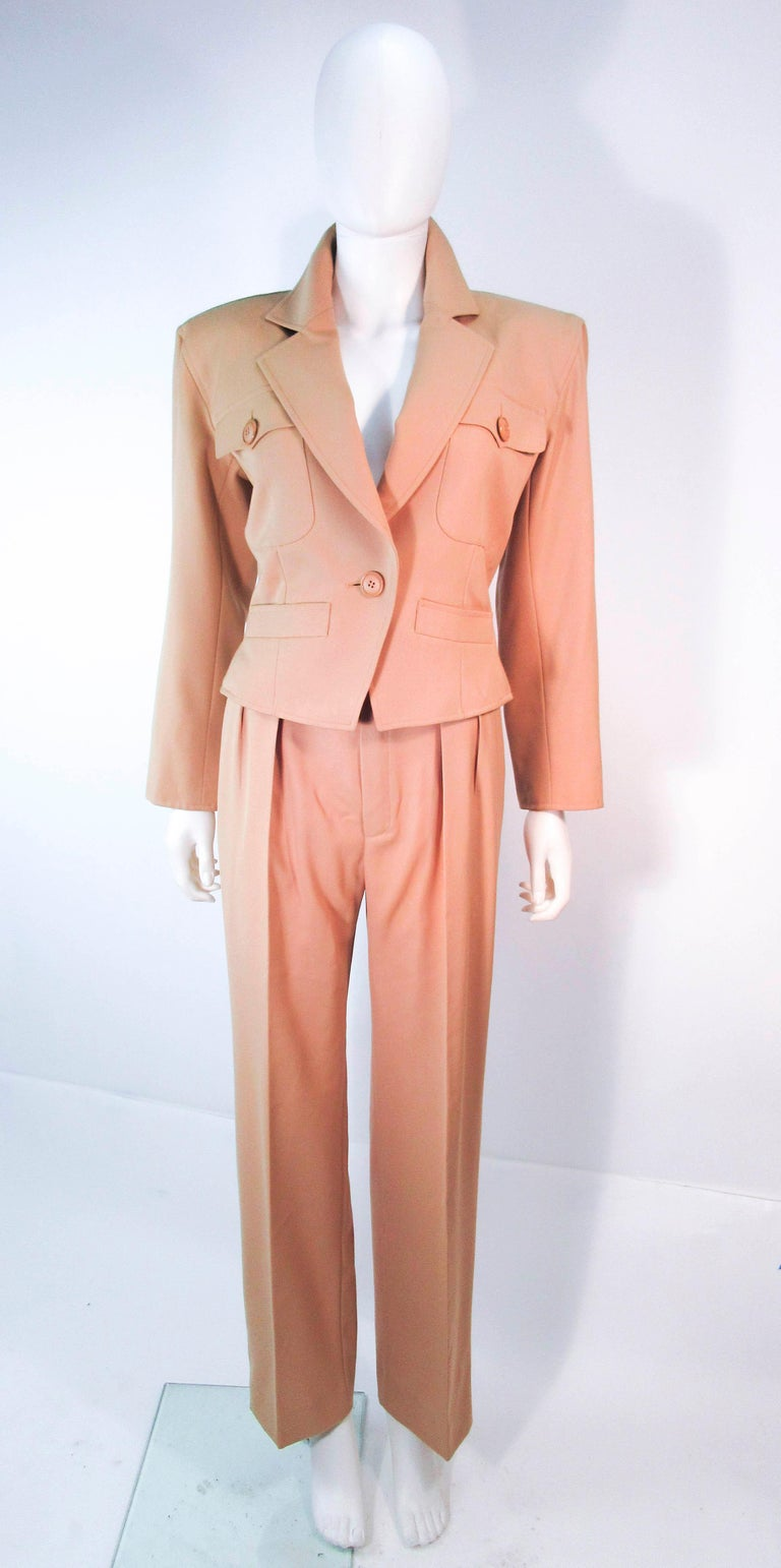 3fdb2029c02 This Yves Saint Laurent suit is composed of a khaki wool. Features a  classic YSL