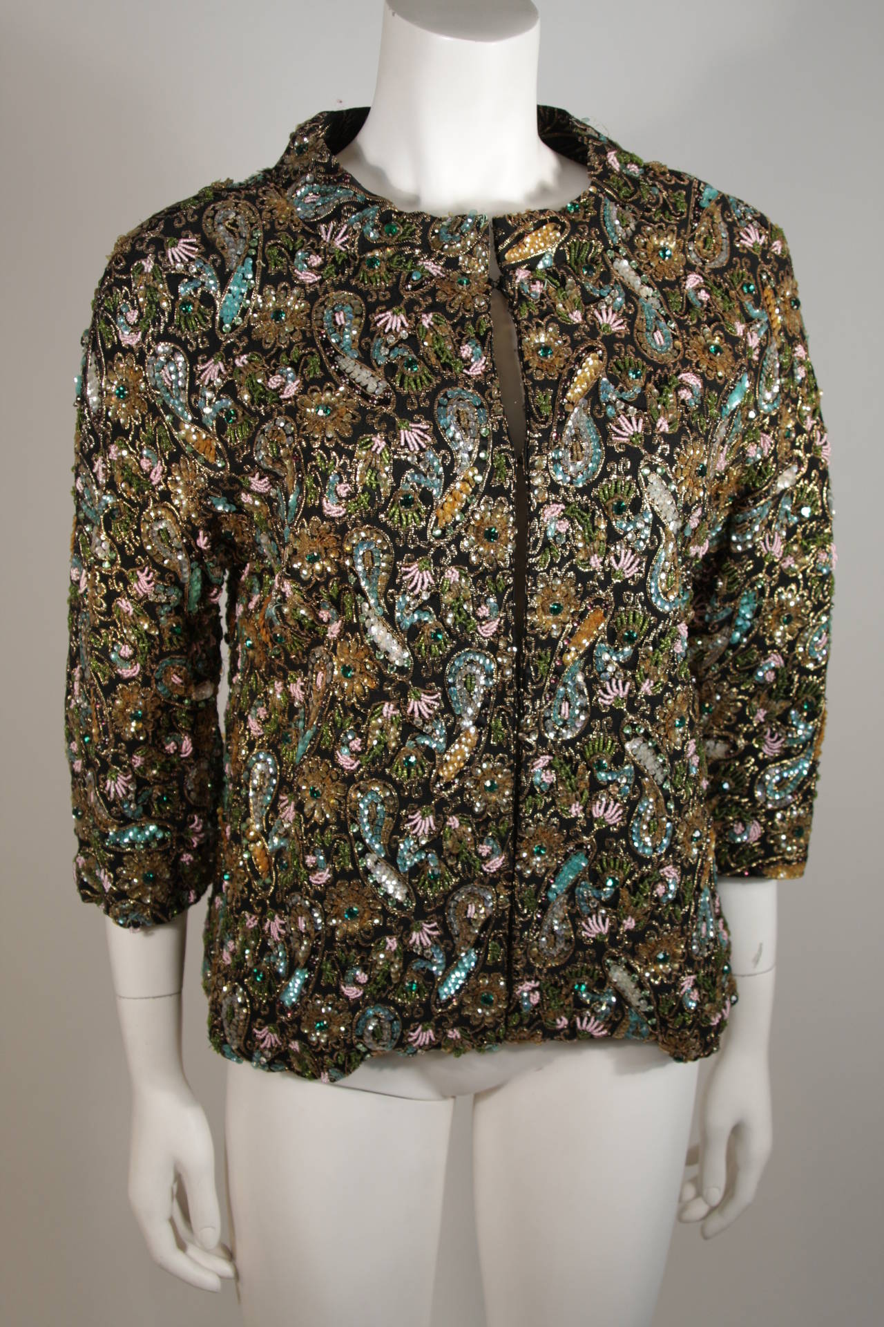 7b8c14ef This beautifully embellished Diane Imports jacket features a heavily beaded  floral motif in aqua, emerald