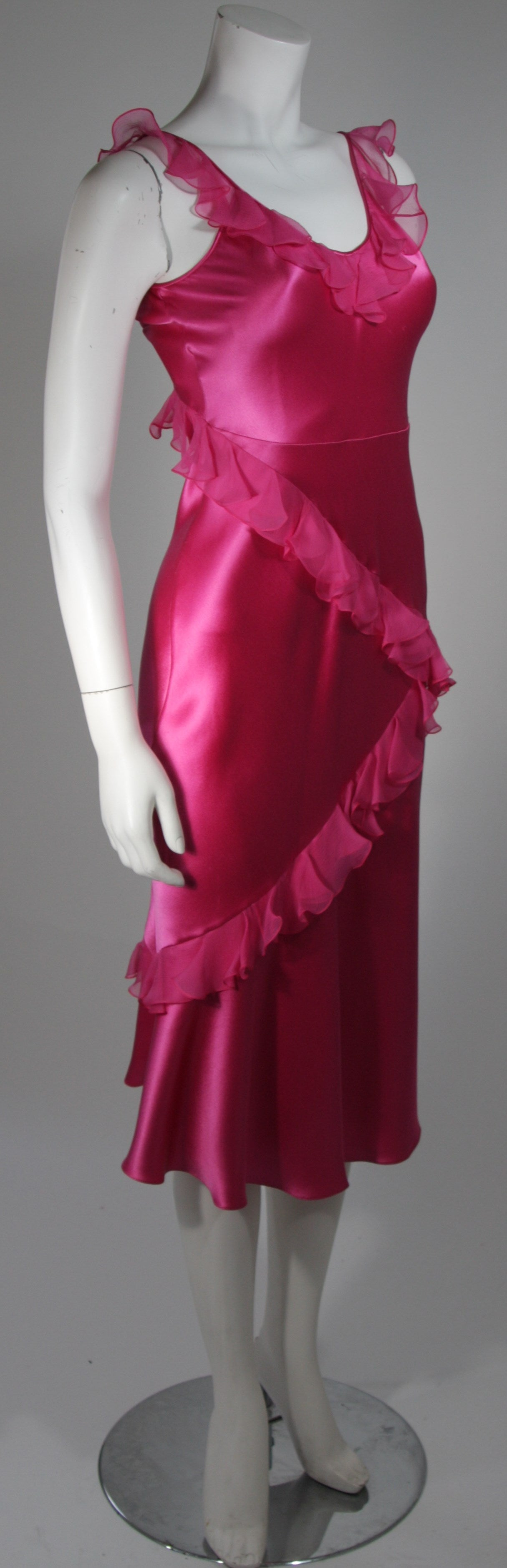 This Christian Dior slip style dress is composed of a vibrant pink silk and silk chiffon combination. The dress is accented with cascading chiffon ruffles. In excellent condition. Great design. Made in France. 
