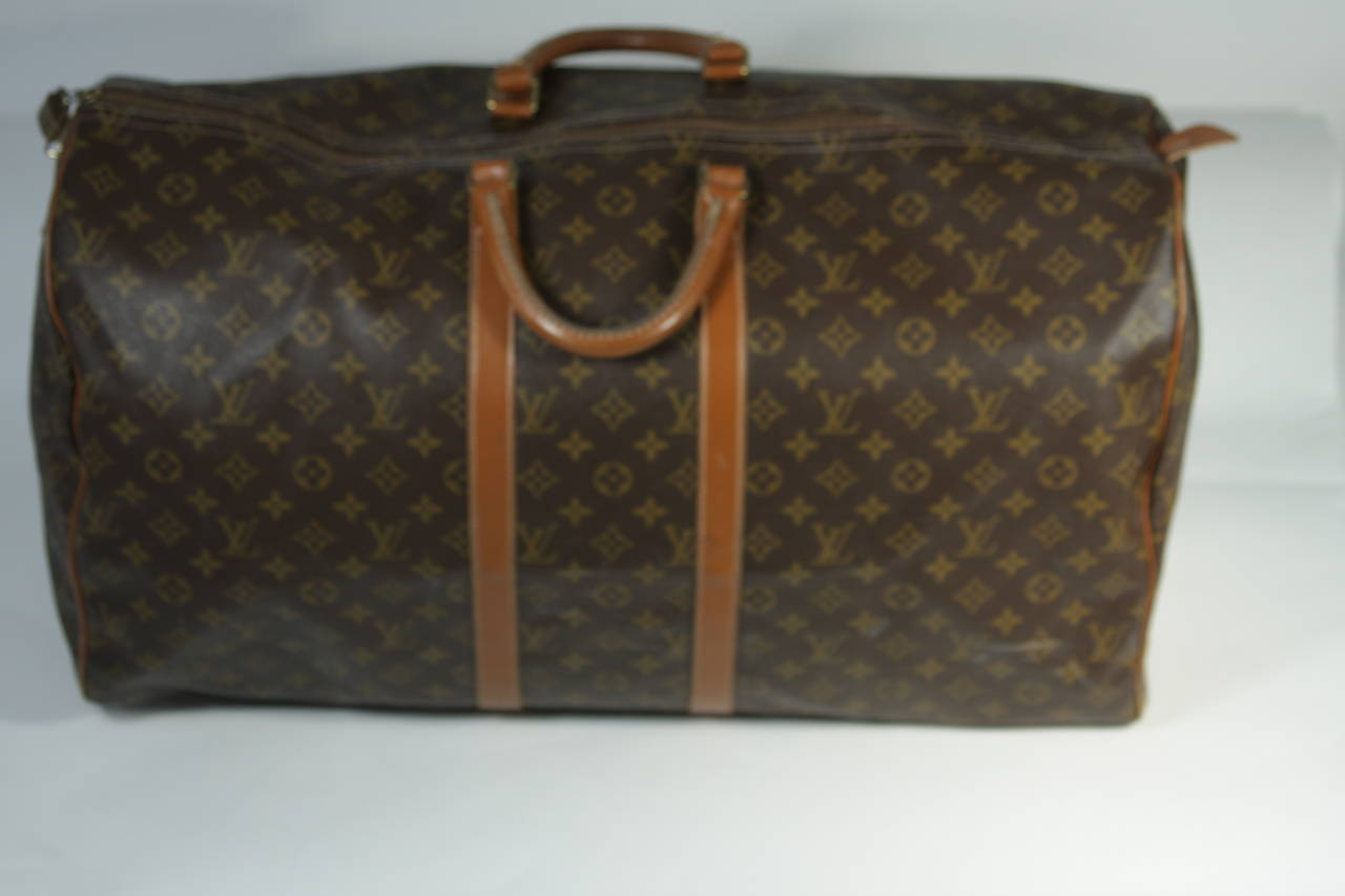 81e4dc50ff86 This vintage Louis Vuitton duffle s available for viewing at our Beverly  Hills Boutique. We