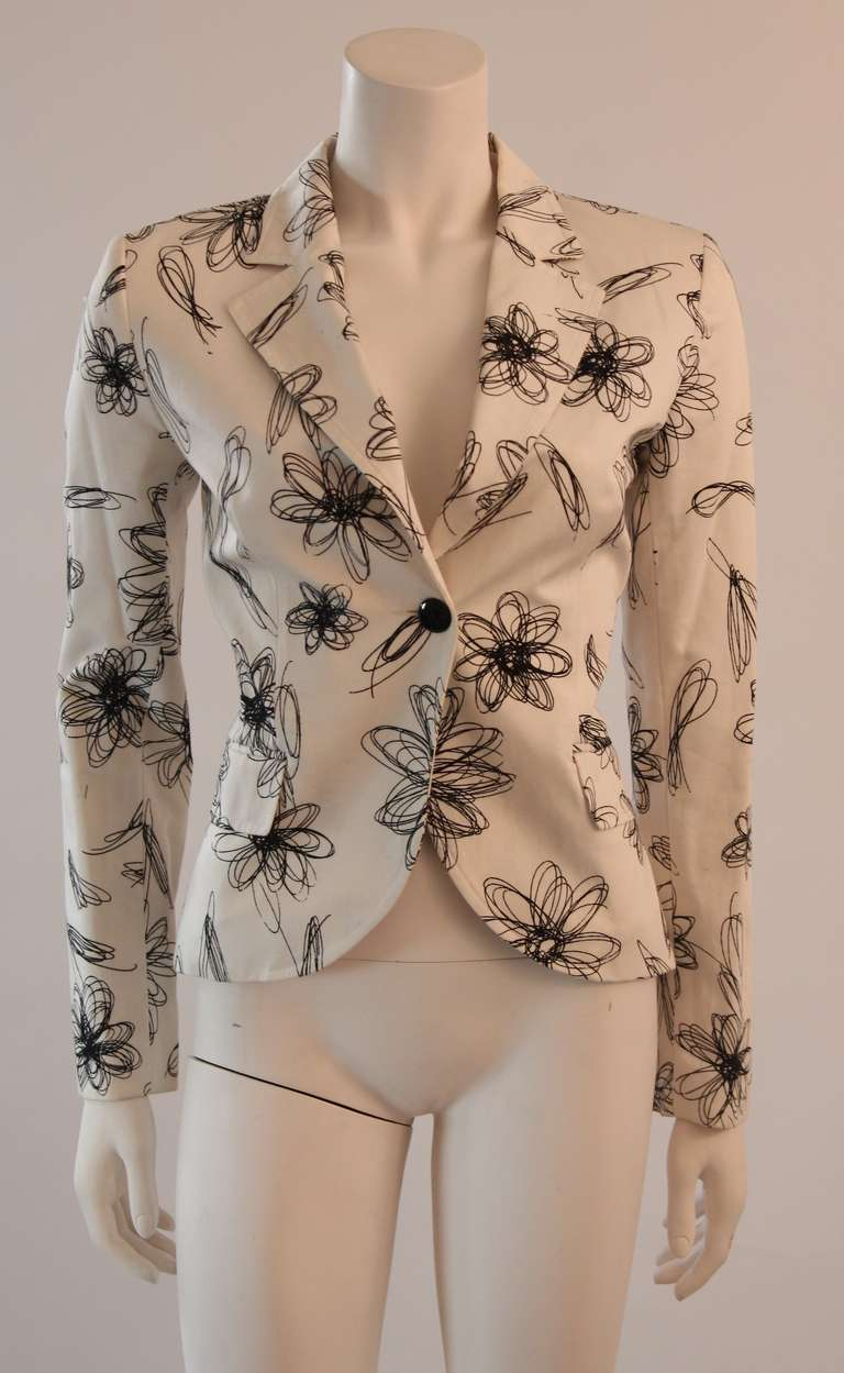 This is a fantastic Moschino Jeans blazer. White heavy yet silky cotton blended twill with a black abstract floral pattern and wonderful single button closure.