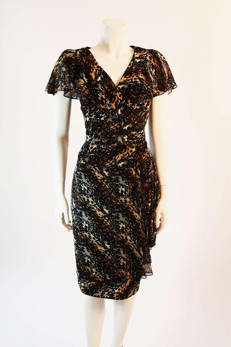 """This is a spectacular Paco Rabanne original design. The cascading ruffle accents of this dress are complimented by the warmth of the watercolor print. The dress features a side zipper and belt detail. An absolutely wonder""""ful dress for Spring,"""