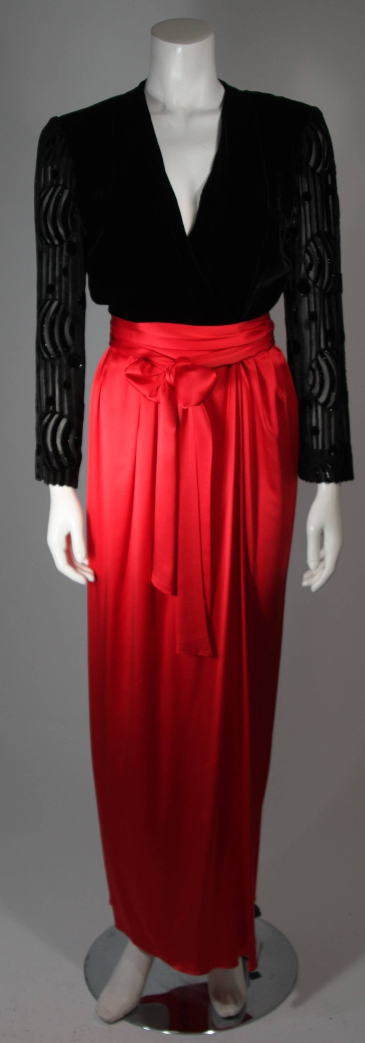 This Adele Simpson gown is an absolute show stopper. It is fashioned with a black velvet bodice with burnout detail and a vibrant true red silk skirt. There are center front openings. In excellent condition and an absolute beauty. 