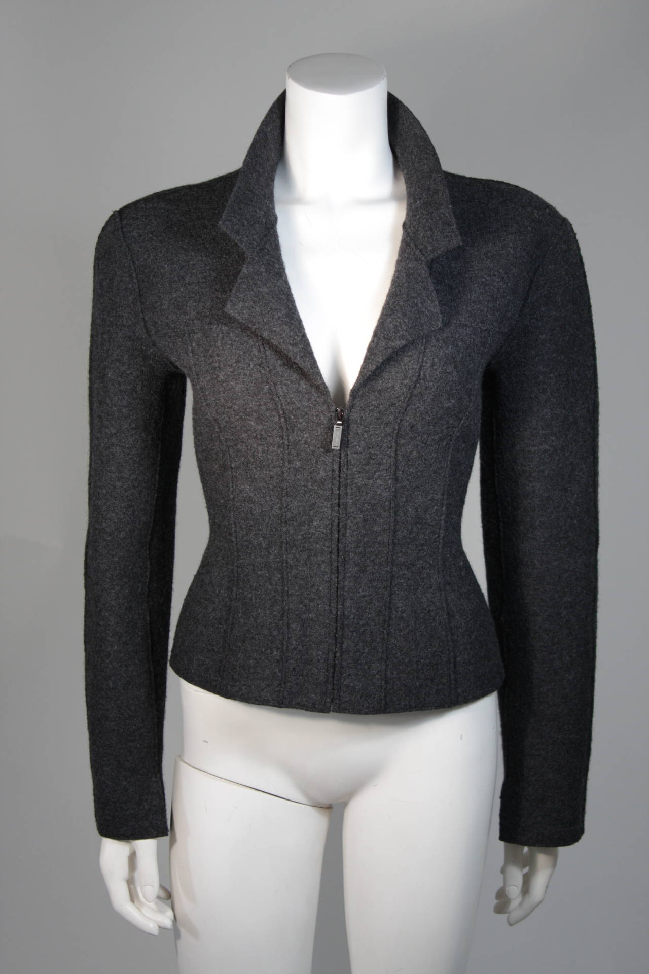 This Chanel jacket is composed of a grey boiled wool. The jacket features pin-tuck contour seams and a zipper at the center front. In excellent condition. Made in France.   **Please cross-reference measurements for personal accuracy. The size