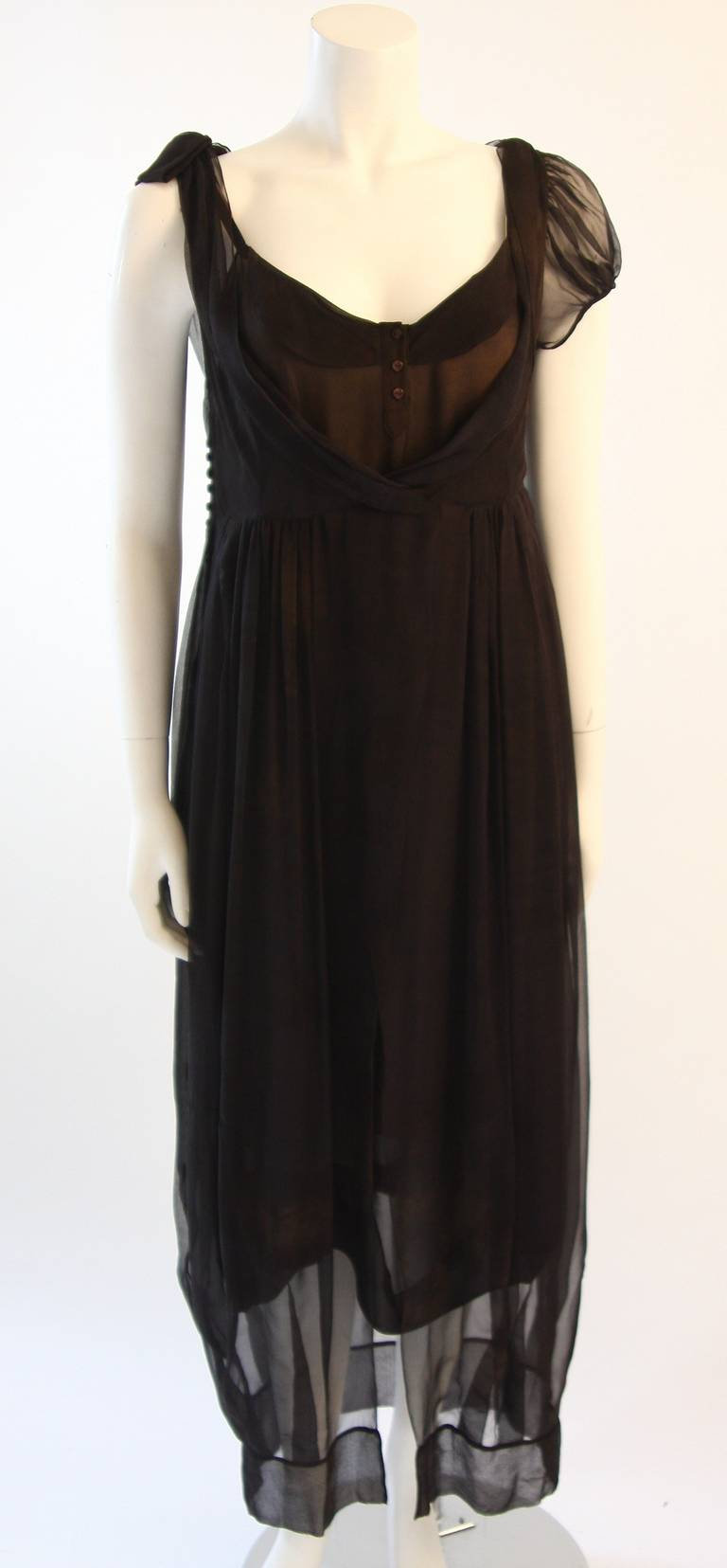This is a chic Zac Posen ensemble. This two piece set can be worn together or styled individually as a dress and, or top. It has a raw and Steam Punk inspired design. The thin silk chiffon has an off black hue with a faded and discolored effect (Off