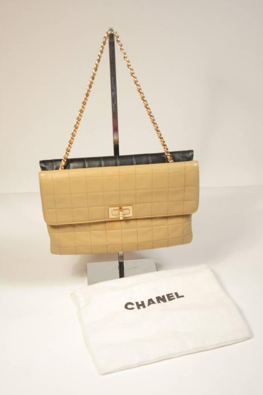 This Chanel Handbag Is Composed Of A Cream And Black Lambskin Leather With Quilted Design
