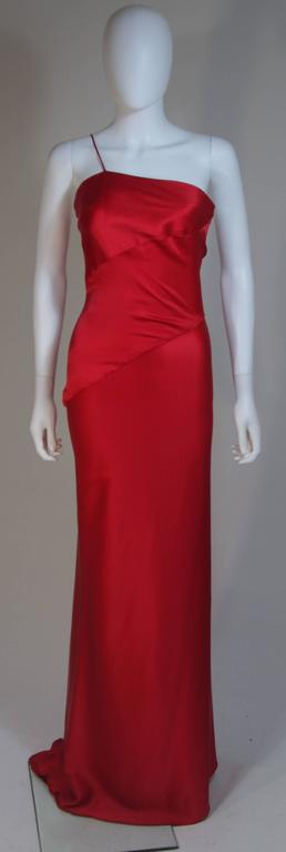 This Cantu & Castillo gown is composed of a red bias cut silk. Features an asymmetrical one shoulder strap design. In excellent condition.     **Please cross-reference measurements for personal accuracy. Size in description box is an
