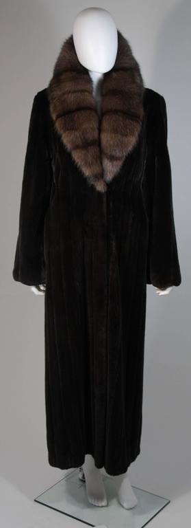 This Valentino coat is composed the finest Black Forest Mink and Sable. The Black Forest Mink pelts are composed of the finest female short guard hairs. This ultra supple coat features a large collar with beautifully aligned pelts. There are center