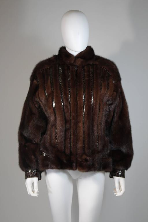 This Giorgio Sant'Angelo coat is composed of a rich brown mink and alligator combination with leather trimming/accents. This ultra supple coat features a center front zipper closure and side pockets. This coat is in excellent condition. Very easy to