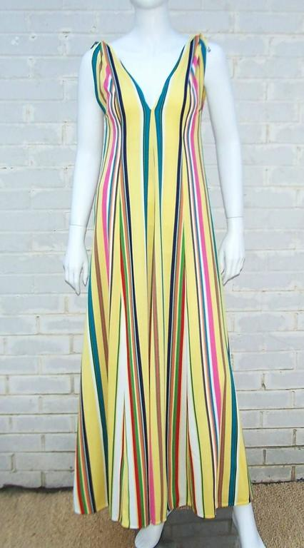 What fun!  This 1970's design by Clovis Ruffin for Keyloun is perfect for poolside, lounging or hostess wear.  The vibrant stripes and modified empire waist are a flattering combination.  The fullness of the skirt and weight of the jersey give