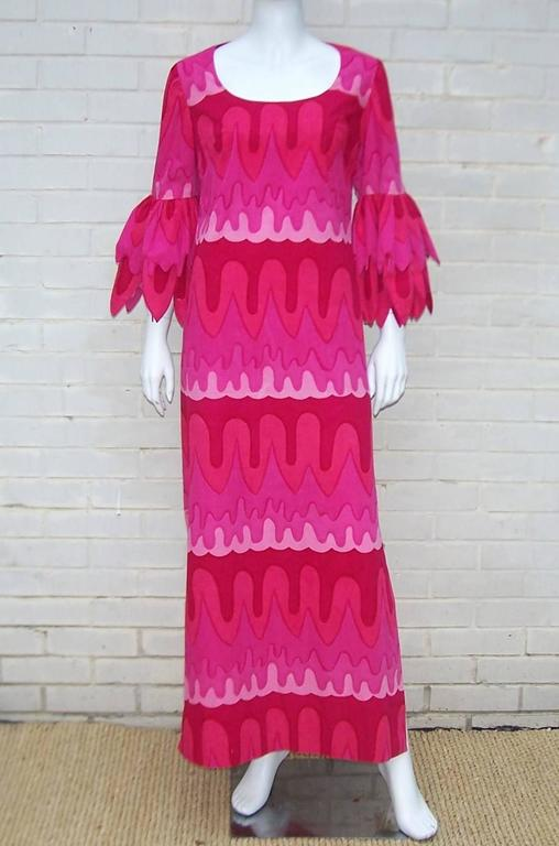 Love the petal sleeves on this vibrant 1970's maxi dress.  The dress is made of a Marimekko style fabric that zips and hooks at the back with one side slit to show a little leg.  So cute and unique...perfect for a party or any festive occasion.