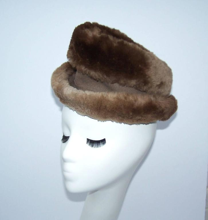 Soft and stylish...this Rose Kraysler hat from the 1940's is so fun to play with.  The body is made from a neutral mousey brown wool felt and trimmed in sheared beaver fur creating texture and volume.  The pointed crown is exaggerated and looks