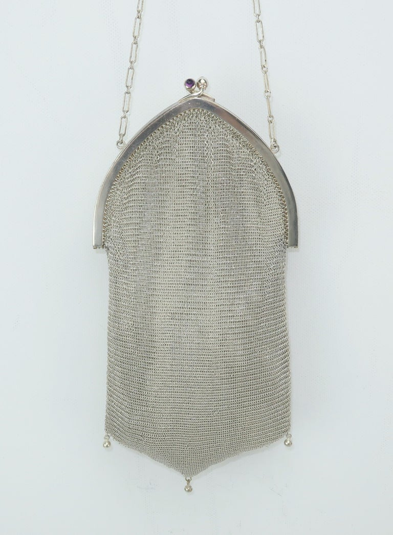 Whiting & Davis has been producing fashionable handbags since the late 1800's and perfected mesh designs in the 1900's that originally were hand formed.  This 1920's version is similar in style to the early Whiting & Davis handbags with the