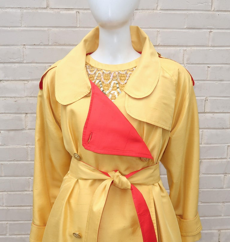 This 1980's cocktail ensemble is channeling the 1960's complete with a sequined mini dress and a coordinating jacket.  Both pieces are designed with a bright yellow and a cardinal red silk shantung fabrics.  The dress is embellished with golden