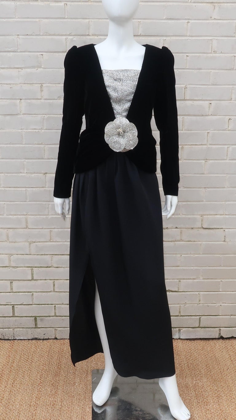 Oh the luxury and opulence of a evening ensemble by the master of feminine designs, Oscar de la Renta!  This two piece outfit consists of a long black silk skirt topped with a black velvet jacket adorned with a silver sequin 'bib' and a detachable