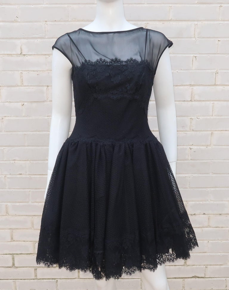 This 'little black dress' by Stanley Platos & Martin Ross has a youthful countenance with ballerina style details to give it something extra.  The flattering silhouette is fitted at the boning lined bodice that features a drop waist skirt