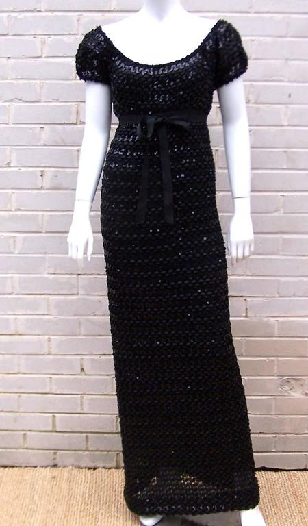 Wowza!  Anne Fogarty outdid herself when she created this crochet ribbon dress.  The body conscious style features an empire waist cinched with a grosgrain ribbon belt and plenty of sequins to catch the light.  It is fully lined with zipper and hook