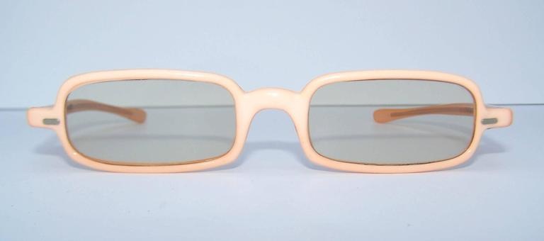 Yeah baby!  These 1960's French sunglasses are a hip vintage accessory perfect for a modern wardrobe.  They are a fleshtone peach color with light gray lenses.  The shape is a pop mod take on the teashades so popular during the era.  Excellent