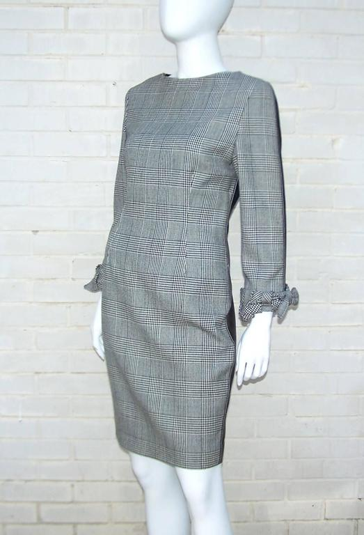 Wowza!  Make a ladylike impression from the front with a demure glen plaid wool dress and then catch their attention with form fitting black leather at the back.  The white contrast stitching on the leather and the lovely basket weave cuffs on the