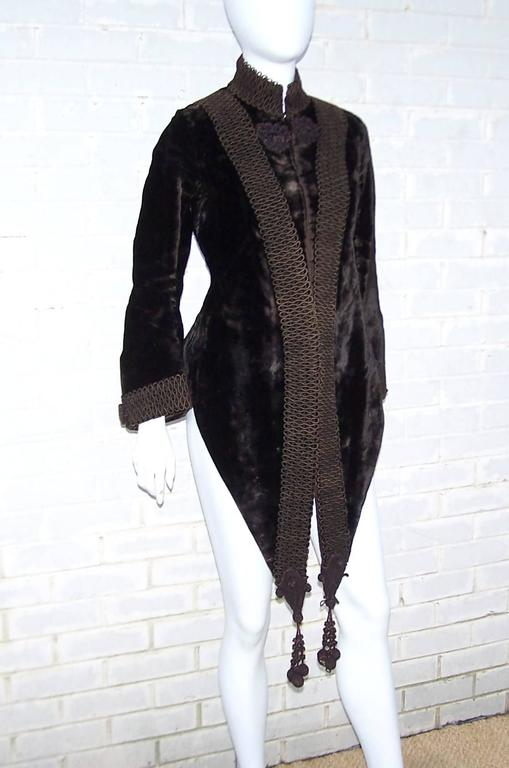 This is a wearable Victorian era mantle coat which creates an amazing style when paired with modern clothing.  The weighty velvet fabric feels like a flat fur and is decorated with soutache at the front and back.  The sleeves are fitted at the top