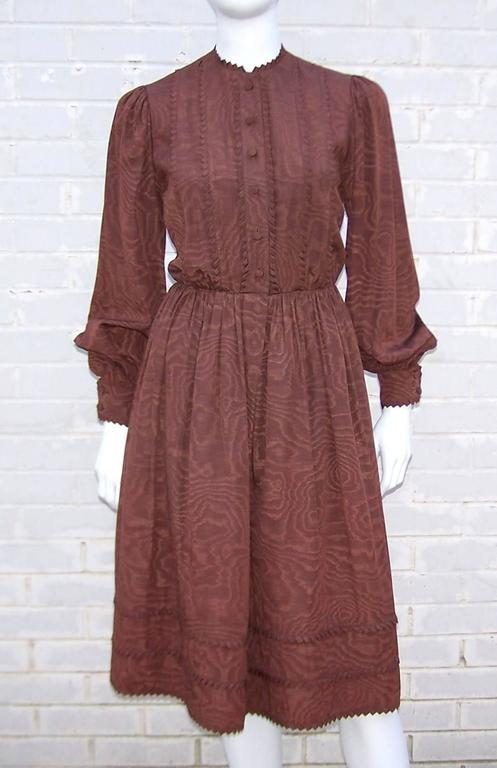 Moire has never looked this good!  This lovely and ladylike Adele Simpson dress has all the function of modern clothing with a definitive nod to Victorian styling.  The simplistic design has stand out details including ribbon trimmed collar, bodice,