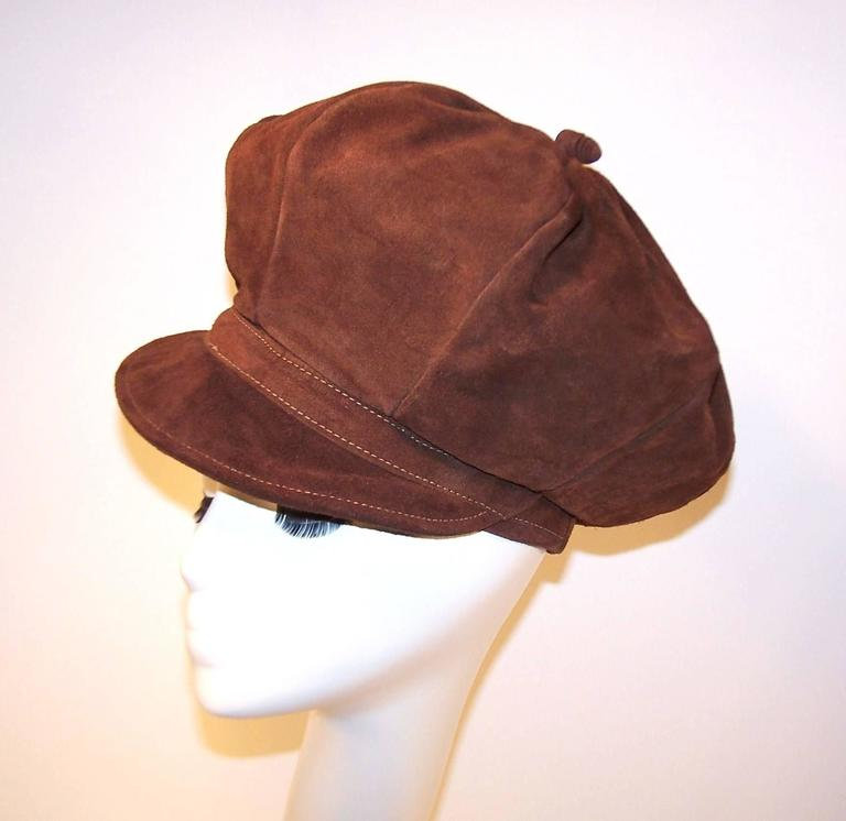 Extra! Extra!  Read all about it! This newsboy cap is reminiscent of the style made popular in the early 1900's with the added exaggeration of a tall crown to lend it a true 1970s bohemian look.  The heavy chocolate brown suede is durable though
