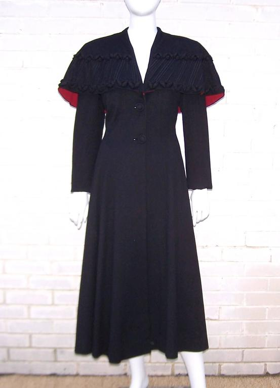 What a stunner!  Eisenberg is best known for producing high quality costume jewelry though they also created clothing until the 1950's.  This 1940's black wool coat has a classic princess coat silhouette with the addition of strong 1940's shoulders