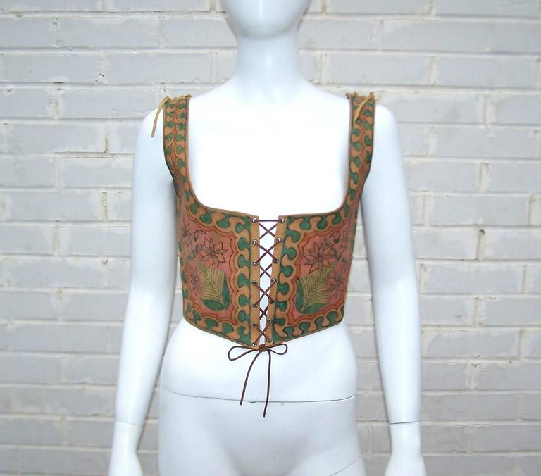 Whether or not you're a pirate, a good wench vest can really come in handy.  Especially when it is a cool hand painted design from Charlotte Blankenship de Vasquez and her Char 'Hecho en Mexico' label.  This early 1970's piece is the classic corset