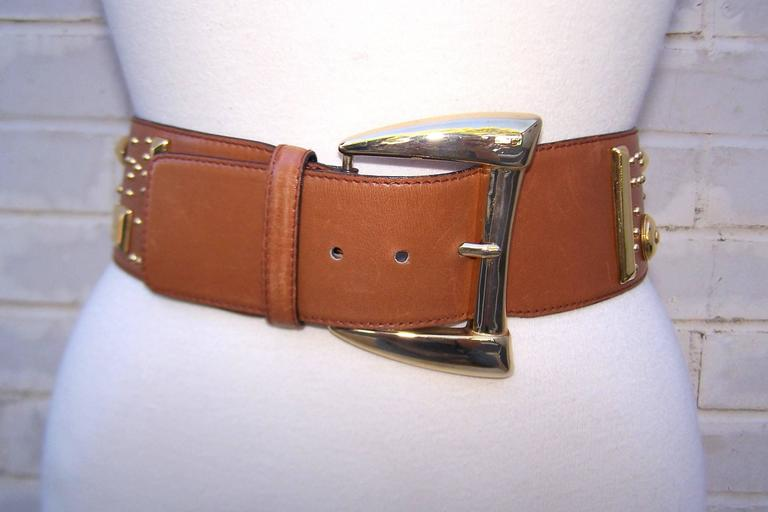 This Escada belt means business!  The neutral camel color leather looks great paired with many other shades and the addition of the gold studs in geometric shapes lends the belt a bohemian vibe sure to spice up an outfit.  Dresses, trousers or the