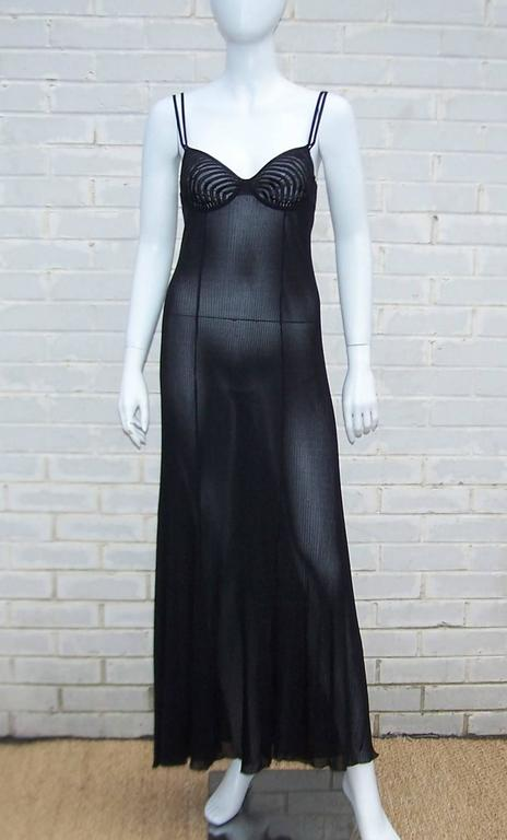 Wowza!  This seductive design by Hanro of Switzerland is almost too good to keep under wraps.  Hanro, a brand that markets itself as 'luxury on the skin', has proven its point with this slinky body conscious gown.  The bra like bodice buttons at the