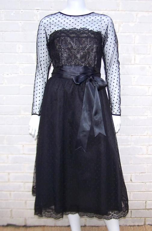 Victor Costa earned a name for himself by designing fashionable and yet affordable evening wear with a nod to the higher end American and French designer labels.  This classic black lace dress is strongly influenced by the nude illusion designs