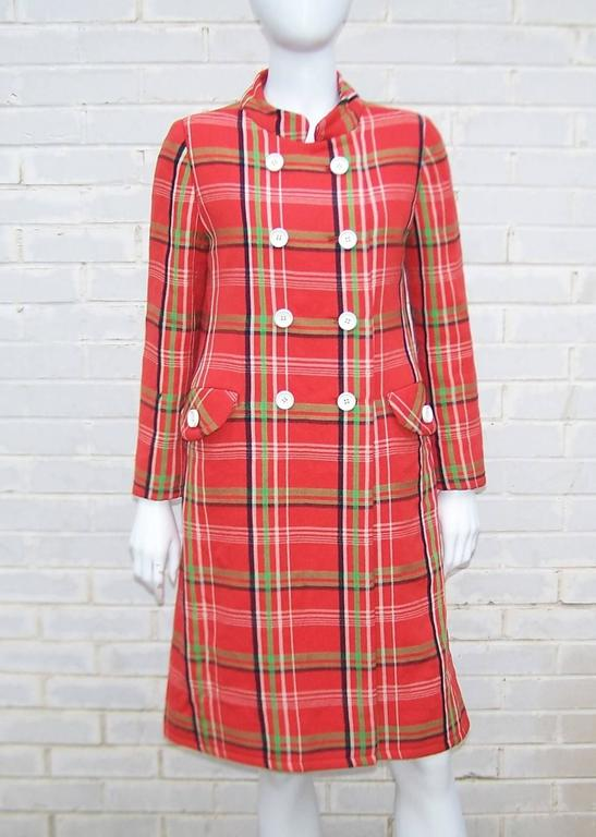 Two for the price of one!  You get all that and more with this adorable John Baldwin dress and coat ensemble from the 1960's.  Mr. Baldwin owned a high end boutique in Florida that catered to wealthy tourists and offered designs that he hand