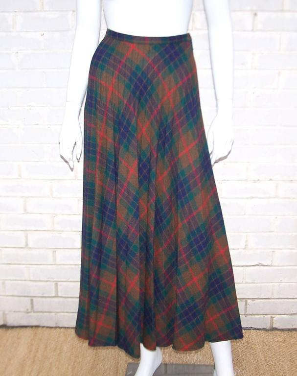 The micro pleating on this plaid wool skirt is a sartorial work of art. It is masterfully pleated to create volume and movement without bulk at the waistband and hips.  The clever design creates a great deal of movement when you walk...all the more