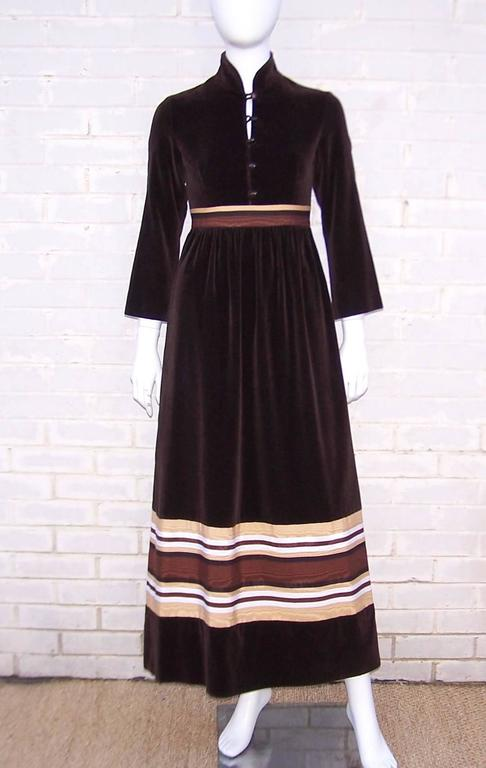 Kay Unger lent her ladylike aesthetics to the A.J. Bari label during the 1970's and this lovely little dress is an example of her work.  The chocolate brown velveteen is graphically enhanced with a tricolor moire fabric at the waist and near the