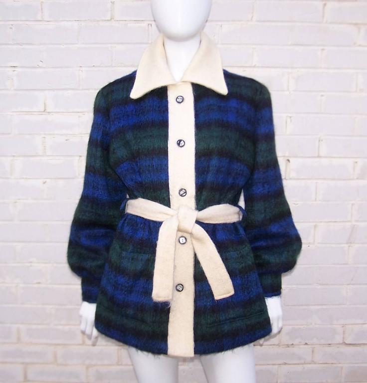 You can't go wrong with a classic Scottish plaid especially when it is a versatile jacket in a cozy mohair.  This comfy jacket by Fraser Cameron buttons at the front with a blue, green and black plaid combination offset by winter white trim and