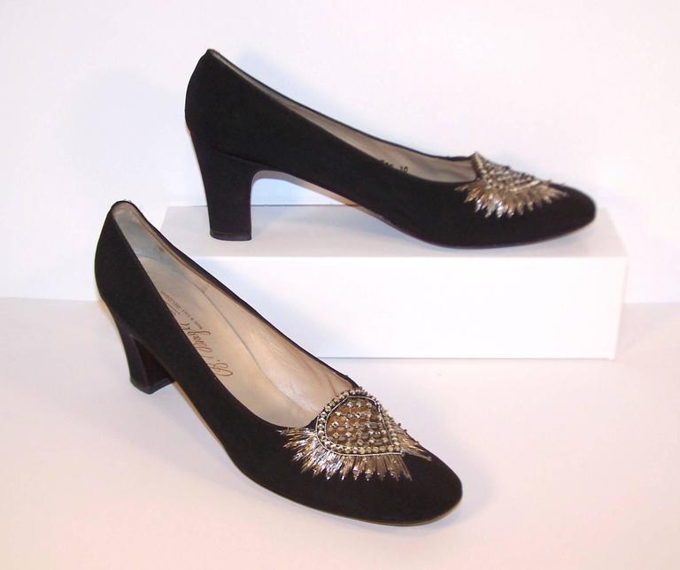 Fit for a queen!  These 1960's Bruno Magli evening shoes are a black silk faille fabric with metallic silver embroidery, beads and sparkling rhinestones at the vamp.  They are elegant and refined with an eye to craftsmanship...all hallmarks of the