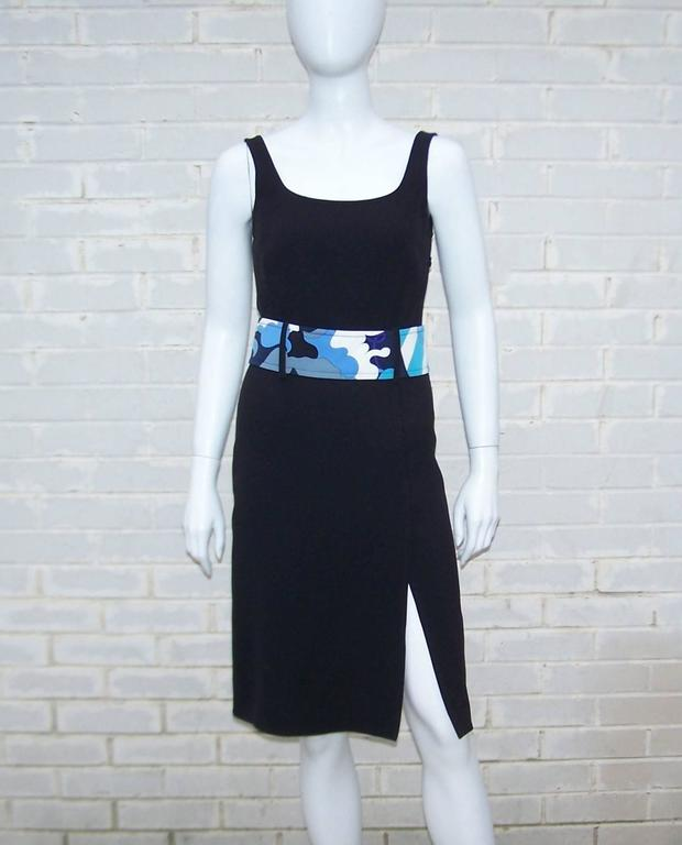 This versatile Emilio Pucci black silk dress will take you from daytime to evening in a flash.  The simple tank style is embellished with a classic Pucci mod printed belt adding a color pop of blue, aqua, white and purple to the mix.  It zips and