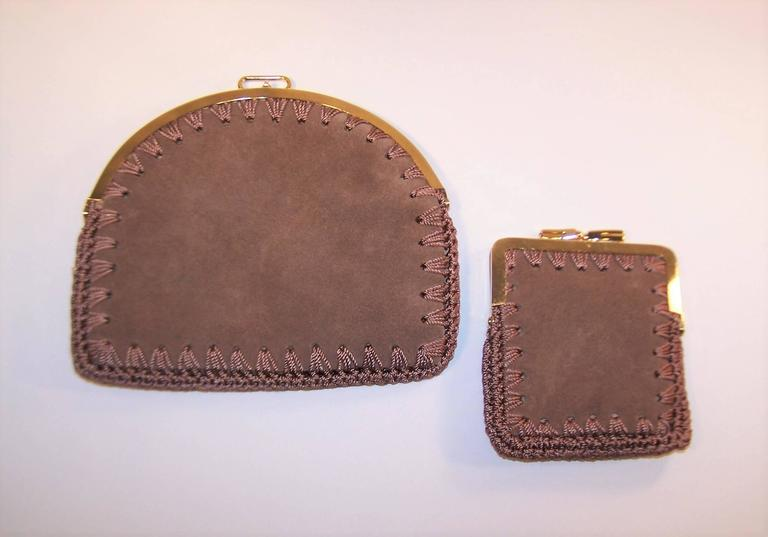 Get out your butterfly net and catch these adorable nesting small suede purses made for Neiman Marcus.  The larger clutch can be used as a small purse or is also suitable for a traveling jewelry case or make up bag.  The smaller bag is perfect as a