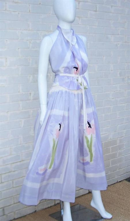 Michaele Vollbracht's talent as a graphic artist is evident in the abstract floral design of the silk fabric used in this 1970's two piece halter dress with coordinating wrap scarf.  The silk fabric is a light lilac purple (though it appears a shade
