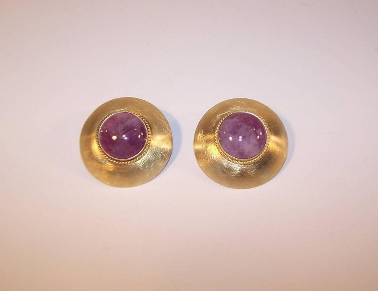 Harlene Korey's hand constructed creations for Kalibre combine a sophisticated style with a casual elegance.  These sterling silver vermeil earrings have a brushed surface with a braided detail framing a domed amethyst quartz.  The combination of